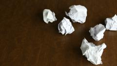 Increasing number of crumpled papers on a desk, close-up, failures, effort - stock footage