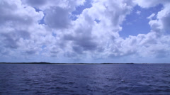 Pan from boat clear skies - turks and caicos Stock Footage