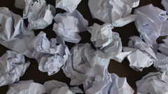 A lot of crumpled papers on a desk, close-up, big failure, effort - stock footage