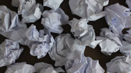 Stock Video Footage of A lot of crumpled papers on a desk, close-up, big failure, effort