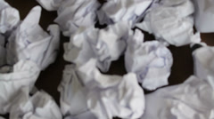 Man trying to create, but has a big failure, a lot of crumpled papers, close-up - stock footage
