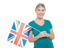 Young UK supporter holding national flag - stock photo