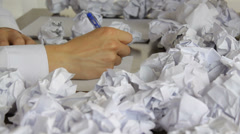 Worker writing at the office, a big failure, close-up - stock footage