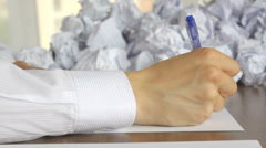Nervous worker writing at the office, a big failure, close-up Stock Footage