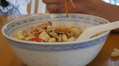 4K Ultra HD time lapse video of eating macaroni with chopsticks (MACRORONI--1) Stock Footage