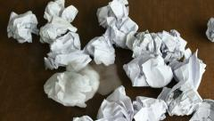 Stock Video Footage of Person throwing a lot of crumpled paper on a desk, close-up, timelapse
