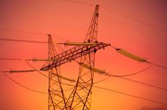 Pylon and transmission power lines in sunset Stock Photos