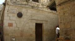 4K UHD Christian Pilgrims visit Via Dolorosa in Old City Jerusalem Stock Footage