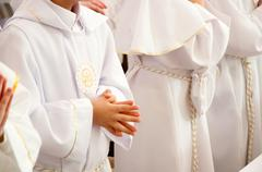 Children accepting the first holy communion Stock Photos