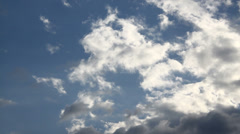 White clouds moving in the sky in summer, close-up Stock Footage