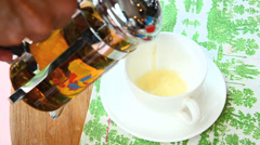 Pouring tea water in tea cup Stock Footage