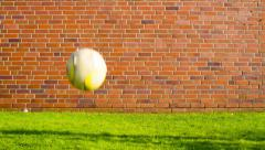 Soccer ball near a brick wall Stock Footage
