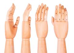 Wooden hand on a white background Stock Photos