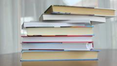 A stack of books on a desk at the office Stock Footage