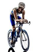 Man triathlon iron man athlete cyclists bicycling Kuvituskuvat