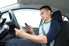 Driver texting Stock Photos