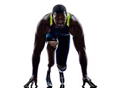 Handicapped man runners sprinters with legs prosthesis silhouettes Stock Photos