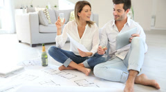 Couple at home celebrating new house purchase Stock Footage
