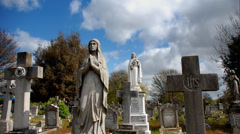 Graveyard. Cemetery. Time-lapse. Virgin Mary Statues Stock Footage