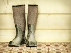retro styled image of an old pair of boots - stock photo