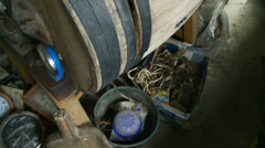 Stock Video Footage of Camera moves around old barn shop contents in Normandy