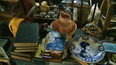 A large collection of old household items - tilt Stock Footage