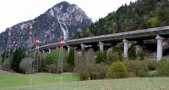 Motorway viaduct and the trellises of high voltage cables Stock Photos