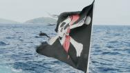 Stock Video Footage of pirate flag is flapping in the wind