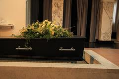 funeral flowers on a casket - stock photo