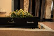 Stock Photo of funeral flowers on a casket