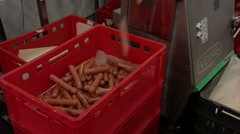 Sausages with conveyor in a box Stock Footage