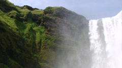 Waterfall's top and spray irrigating grass & moss on cliff Stock Footage