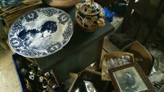 Old photographs & family heirlooms for sale Stock Footage