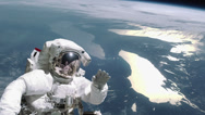 Astronaut takes a space walk in outer space Stock Footage