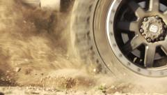 Super Slow Motion Wheel Spinning In Dirt Offroad - stock footage