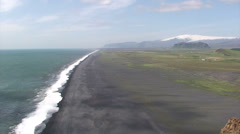 Very long black sand beach and mountain with glacier Stock Footage