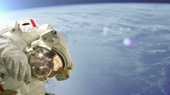 Astronaut reaches out while on a spacewalk - stock footage
