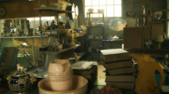 Stack of old books, pots, family heirlooms Stock Footage