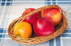 large apples in a wattled basket. - stock photo