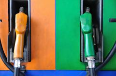 gasoline nozzles figure separate type by color. - stock photo