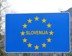 Blue sign with yellow stars of european border slovenija 1 Stock Photos