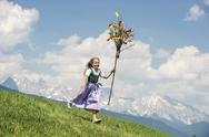 Stock Photo of Austria, Salzburg State, Altenmarkt/Zauchensee, girl with Palmbusch running down