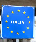 blue sign with yellow stars of european border italia 3 - stock photo
