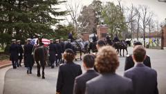 Military funeral marching into Arlington National Cemetery in slow motion Stock Footage