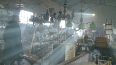 Light rays in barn Normandy flea market Stock Footage