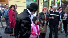 Circus man on street show, birds, small animals, Charlie Chaplin character Stock Footage