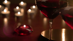 Wineglasses in candlelight Stock Footage