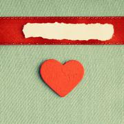 Valentines day background. paper blank heart on green fabric material Stock Photos