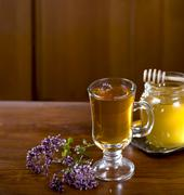 Still life from medicinal herbs, honey, herbal tea - stock photo