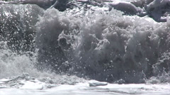 Surf and breaking wave on black sand beach, extreme detail - stock footage